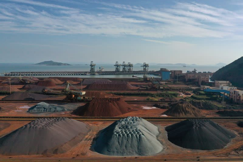 FILE PHOTO: Piles of imported iron ore are seen at a port in Zhoushan, Zhejiang