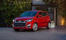 """<p>The <a href=""""https://www.caranddriver.com/chevrolet/spark"""" rel=""""nofollow noopener"""" target=""""_blank"""" data-ylk=""""slk:Chevrolet Spark"""" class=""""link rapid-noclick-resp"""">Chevrolet Spark</a> has a sub-$15,000 starting price, making it the <a href=""""https://www.caranddriver.com/features/g34908888/10-cheapest-new-cars-for-2021/"""" rel=""""nofollow noopener"""" target=""""_blank"""" data-ylk=""""slk:cheapest new car sold in the U.S. for 2021"""" class=""""link rapid-noclick-resp"""">cheapest new car sold in the U.S. for 2021</a>. It's 98-hp four-cylinder doesn't party, but we have to give the Spark a little credit for offering a manual transmission, even though its CVT is more efficient. The Spark makes the most out of its nine gallon fuel tank, getting an EPA-estimated 297 miles on a single tank of gas. We managed 37 mpg during our 75-mph highway fuel-economy test in a Spark LT.</p><ul><li>Base price: $14,395</li><li>Fuel Economy EPA combined/city/highway: 33/30/38 mpg (CVT)</li><li>Horsepower: 98 hp</li></ul><p><a class=""""link rapid-noclick-resp"""" href=""""https://www.caranddriver.com/chevrolet/spark/specs"""" rel=""""nofollow noopener"""" target=""""_blank"""" data-ylk=""""slk:MORE SPARK SPECS"""">MORE SPARK SPECS</a></p>"""