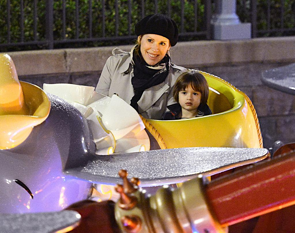 EXCLUSIVE: Molly Ringwald was all smiles before taking flight on the Dumbo ride at Disneyland with one of her twins, Roman.