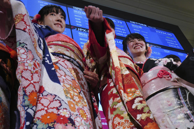 Kimono-clad employees of the Tokyo Stock Exchange and models walk out from the stage during a ceremony marking the start of this year's trading in Tokyo Monday, Jan. 6, 2020, in Tokyo. (AP Photo/Eugene Hoshiko)