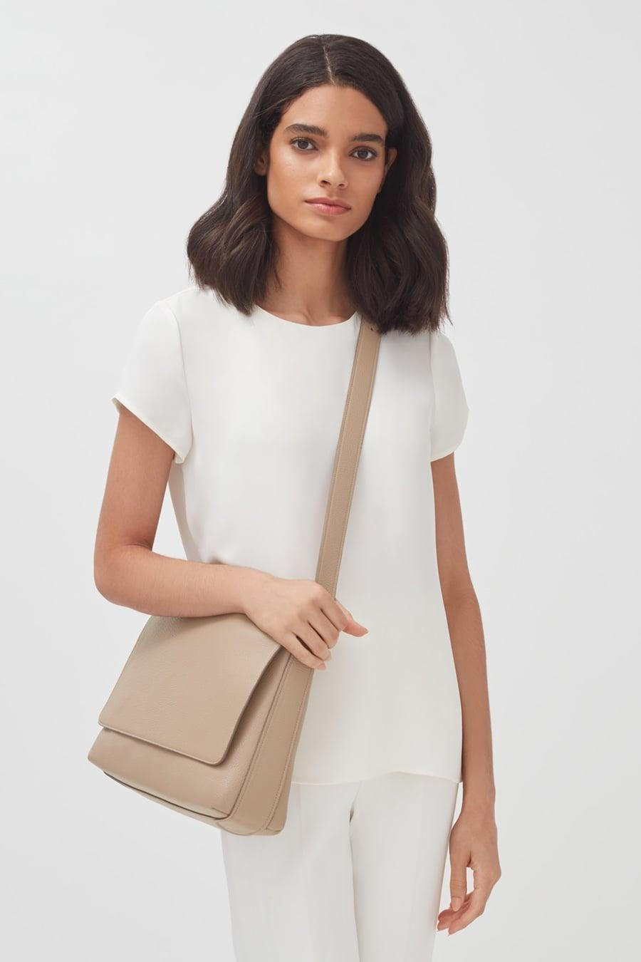 <p>You can fit so much in this handy <span>Cuyana Messenger Bag</span> ($345).</p>