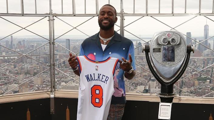 Aug 17, 2021; New York, New York, USA; New York Knicks guard Kemba Walker (8) poses for a photo during a photo shoot on the 86th floor observation deck of the Empire State Building.