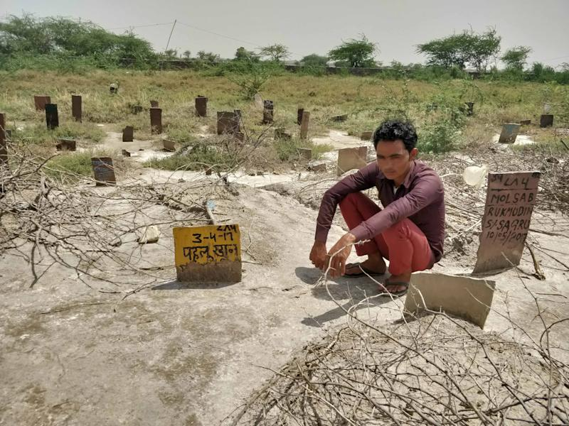 Pehlu Khan's son Irshad sits next to his father's grave near their home in Jaisinghpur, Haryana. (Eram Agha/News18.com)