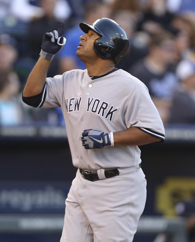 KANSAS CITY, MO - MAY 11: Vernon Wells #12 of the New York Yankees celebrates his two-run home run in the fifth inning against the Kansas City Royals at Kauffman Stadium on May 11, 2013 in Kansas City, Missouri. (Photo by Ed Zurga/Getty Images)