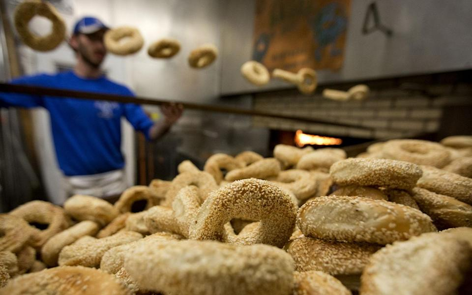 <p>For anyone raised on New York-style bagels—or the pale simulacra available in the freezer at your grocery store—Montreal's bagels are a revelation. The Montreal bagel is boiled in water sweetened with honey, baked in long rows in enormous wood-fired ovens, and (ideally) served warm. Local favorites include St-Viateur and Fairmount, both in the Mile End neighborhood.</p>