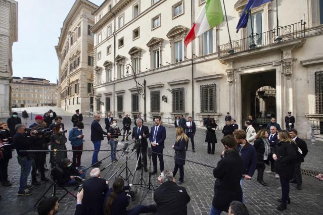 Matteo Salvini, centre, makes a statement on Monday (AP)