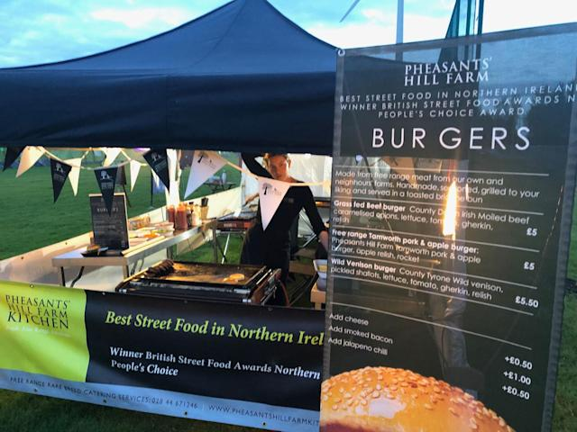 """<div class=""""caption""""> A food stand in the Camping Village offers hot meals and cold beverages. </div> <cite class=""""credit"""">Brian Wacker</cite>"""