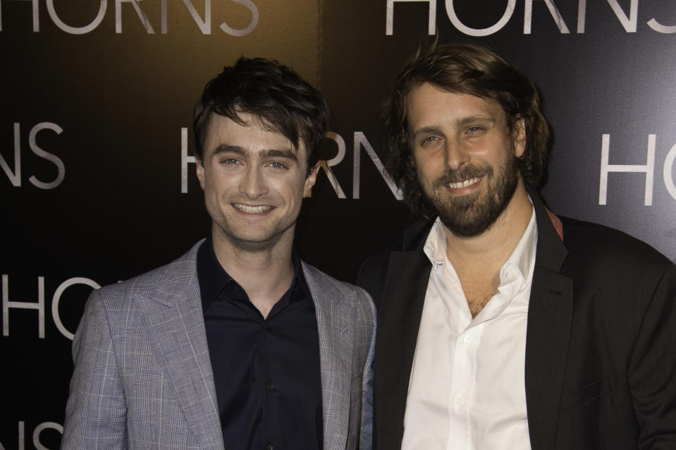 Daniel Radcliffe and director Alexandre Aja attend the 'Horns' premiere on September 16, 2014. (Photo by Stephane Cardinale/Corbis via Getty Images)