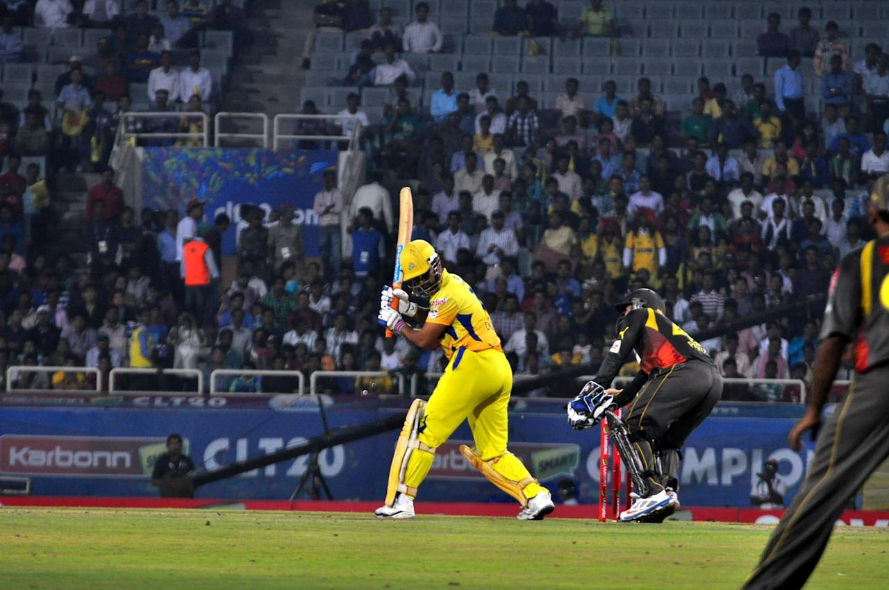 Chennai Super Kings captain MS Dhoni plays a shot against Hyderabad Sunrisers at Champions League Twenty-20 match at Jharkhand State Cricket Association (JSCA) International Cricket Stadium in Ranchi on Sept. 26, 2013. (Photo: IANS)