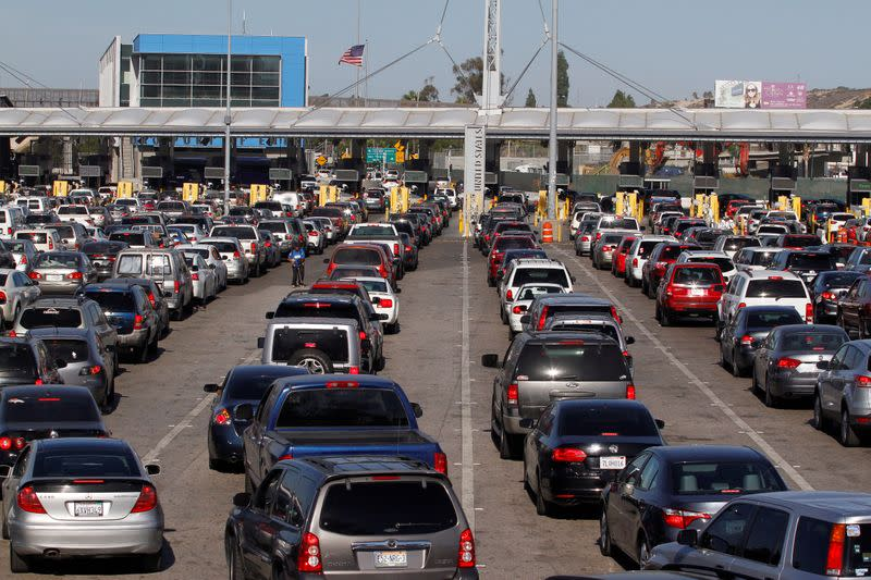 Cars stand in multiple lines as they wait to be inspected by U.S. border patrol officers to enter from Mexico to the U.S., at the San Ysidro point of entry, in Tijuana