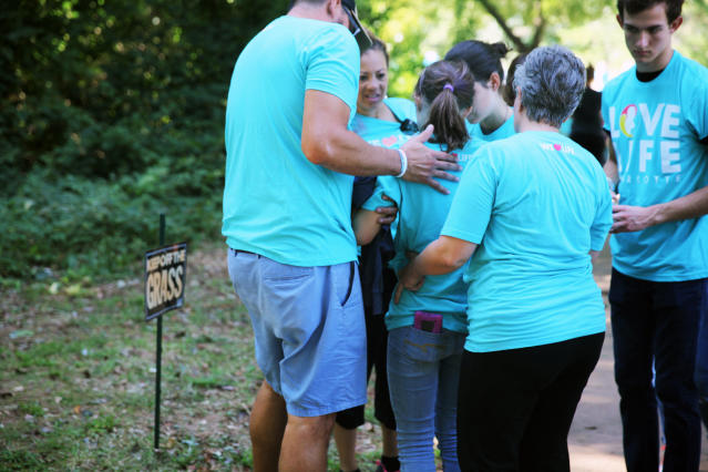 A young member of Love Life Charlottetries to stand up after suffering dehydration and heat exhaustion on Saturday. (Jenavieve Hatch/HUFFPOST)