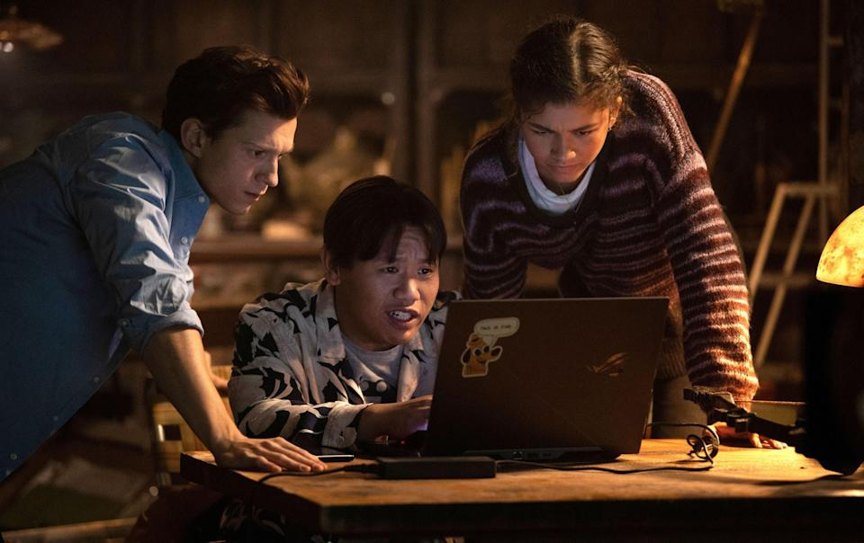 Peter and his friends looking at a laptop