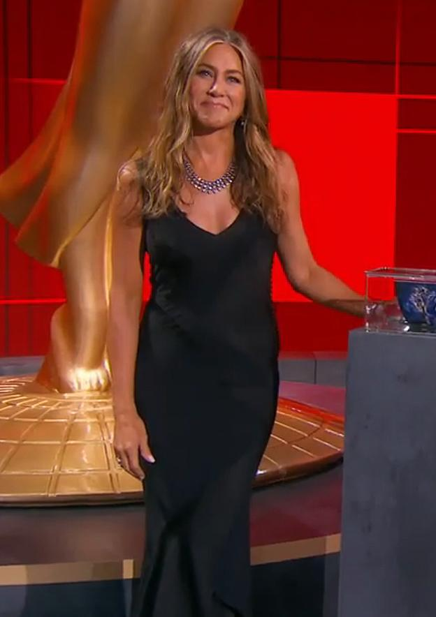 """<p>The<em>Morning Show</em> nominee <a href=""""https://people.com/style/jennifer-aniston-2020-emmys-sexy-black-gown/"""">went for her signature sexy black slip dress</a> when she opened the show with host Jimmy Kimmel, pairing the look with jewels and soft waves. (She even dressed up her dogs Sophie and Clyde in pet-appropriate evening wear.)</p>"""