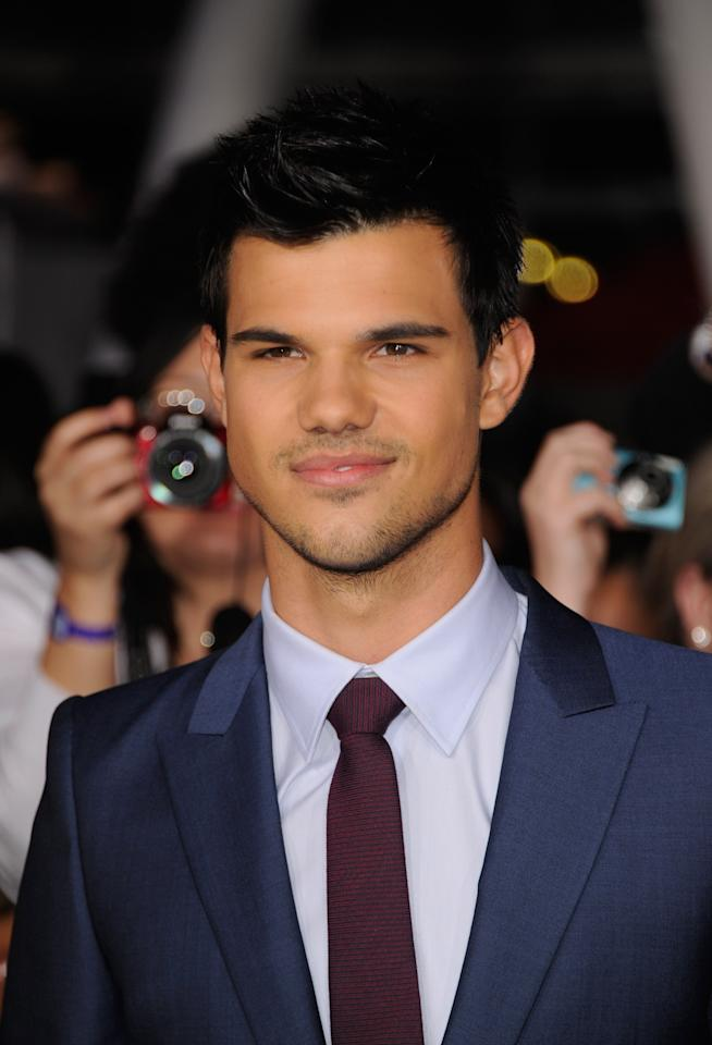 "LOS ANGELES, CA - NOVEMBER 14:  Actor Taylor Lautner arrives at Summit Entertainment's ""The Twilight Saga: Breaking Dawn - Part 1"" premiere at Nokia Theatre L.A. Live on November 14, 2011 in Los Angeles, California.  (Photo by Frazer Harrison/Getty Images)"
