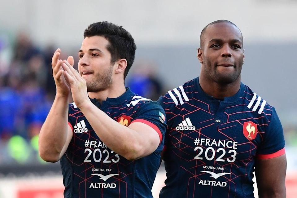 France's fullback Brice Dulin (L) and prop Eddy Ben Arous celebrate after winning 40-18 their Six Nations rugby union match against Italy, at the Olympic Stadium in Rome, on March 11, 2017 (AFP Photo/Miguel Medina)