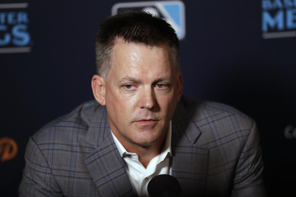 In this Dec. 10, 2019, file photo, Houston Astros manager A.J. Hinch speaks during the Major League Baseball winter meetings, in San Diego. Houston  manager AJ Hinch and general manager Jeff Luhnow were suspended for the entire season Monday, Jan. 13, 2020,  and the team was fined $5 million for sign-stealing by the team in 2017 and 2018 season. Commissioner Rob Manfred announced the discipline and strongly hinted that current Boston manager Alex Cora — the Astros bench coach in 2017 — will face punishment later. Manfred said Cora developed the sign-stealing system used by the Astros. (AP Photo/Gregory Bull, File)