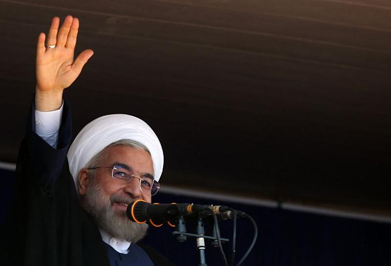 A handout picture released by the official website of the Iranian president shows President Hassan Rouhani speaking in Khoramabad on June 18,2014 (AFP Photo/)