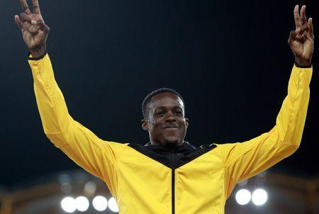 FILE PHOTO: Athletics - Gold Coast 2018 Commonwealth Games - Men's 110m Hurdles Final - Carrara Stadium - Gold Coast, Australia - April 10, 2018. Gold medalist Ronald Levy of Jamaica celebrates. REUTERS/Athit Perawongmetha