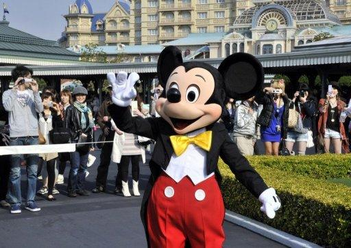 Mickey Mouse waves to visitors at Tokyo Disneyland. Same sex couples are able to hold fairytale wedding ceremonies at hotels inside the popular Tokyo Disney Resort, including at the Cinderella Castle, a company spokeswoman said