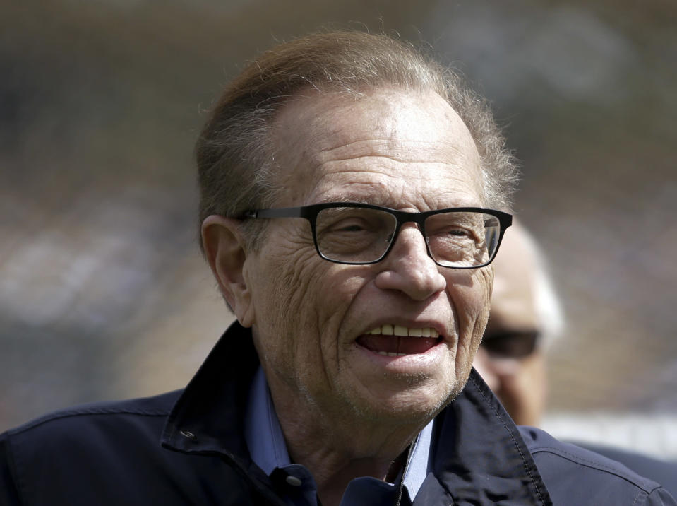 FILE - This April 1, 2013 file photo shows talk show host Larry King attends a season-opening baseball game between the Los Angeles Dodgers and the San Francisco Giants in Los Angeles. King, who interviewed presidents, movie stars and ordinary Joes during a half-century in broadcasting, has died at age 87. Ora Media, the studio and network he co-founded, tweeted that King died Saturday, Jan. 23, 2021 morning at Cedars-Sinai Medical Center in Los Angeles. (AP Photo/Jae C. Hong, File)