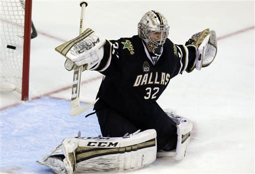 Dallas Stars goalie Kari Lehtonen (32) stretches but cannot stop the goal-shot for a score by Chicago Blackhawks Johnny Oduya during the second period of an NHL hockey game on Saturday, March 16, 2013, in Dallas. (AP Photo/LM Otero)