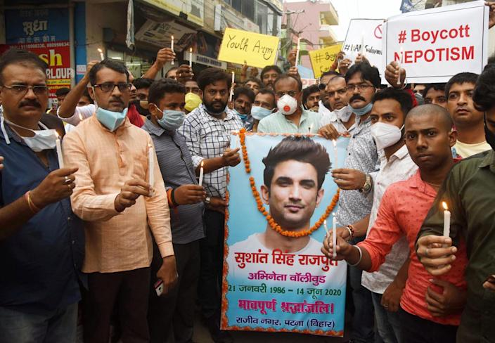 Fans during a candle march against the Bollywood industry after actor Sushant Singh Rajput's death, at Rajeev Nagar on June 16, 2020 in Patna, India. (Photo Santosh Kumar/Hindustan Times via Getty Images)