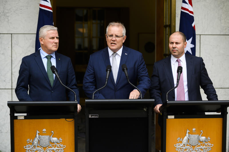 CANBERRA, AUSTRALIA - JANUARY 06: Prime Minister Scott Morrison speaks alongside Deputy Prime Minister Michael McCormack and Treasurer Josh Frydenberg at Parliament House on January 06, 2020 in Canberra, Australia. One person has died in Batlow and four firefighters were injured in NSW overnight. 14 people have now died in the fires in NSW, Victoria and South Australia since New Year's Eve. Prime Minister Scott Morrison on Saturday announced army reservists were being called up to help with firefighting efforts across Australia, along with extra Defence ships and helicopters. The Prime Minister has faced ongoing criticism over his handling of the ongoing bushfire crisis, most recently over the Liberal Party's release of advertising detailing the Government's bushfire response. (Photo by Rohan Thomson/Getty Images)