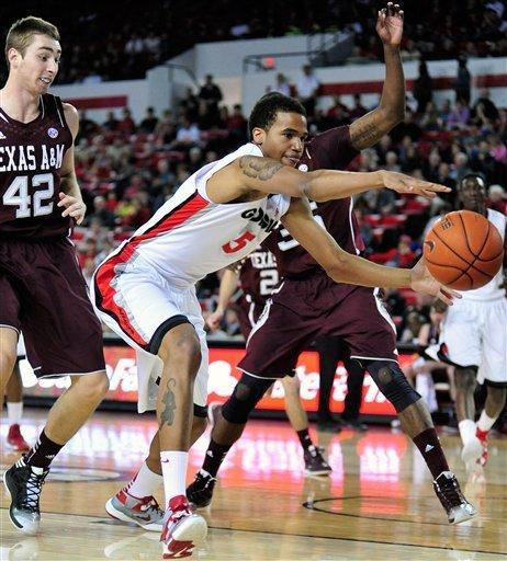Georgia forward Tim Dixon (5) tries to keep the ball in play as Texas A&M forward Jarod Jahns (42) watches during the first half of an NCAA college basketball game Saturday, Feb. 9, 2013, in Athens, Ga. (AP Photo/Athens Banner-Herald, Richard Hamm)