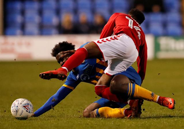 "Soccer Football - League One - Shrewsbury Town vs Charlton Athletic - Montgomery Waters Meadow, Shrewsbury, Britain - April 17, 2018 Shrewsbury Town's Aristote Nsiala in action with Charlton's Tarique Fosu Action Images/Andrew Boyers EDITORIAL USE ONLY. No use with unauthorized audio, video, data, fixture lists, club/league logos or ""live"" services. Online in-match use limited to 75 images, no video emulation. No use in betting, games or single club/league/player publications. Please contact your account representative for further details."