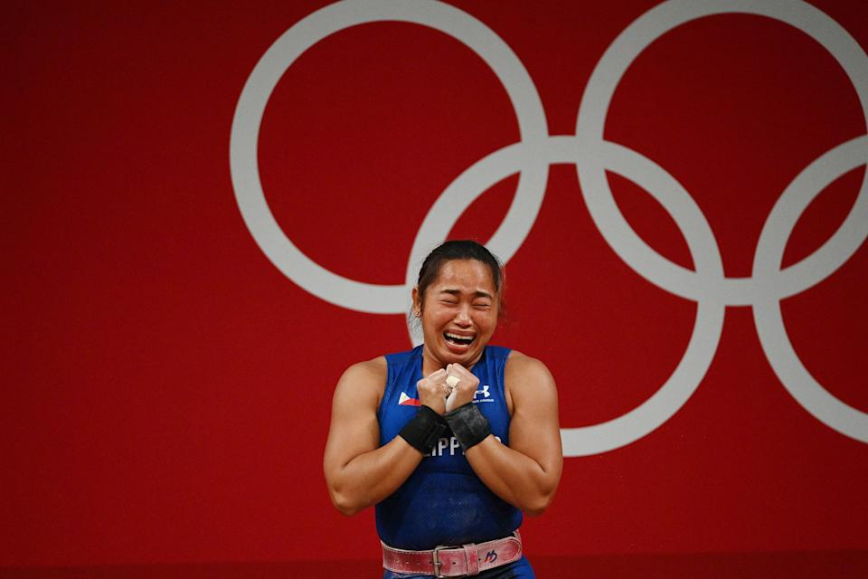 Philippines' Hidilyn Diaz reacts after placing first in the women's 55kg weightlifting competition during the Tokyo 2020 Olympic Games at the Tokyo International Forum in Tokyo on July 26, 2021. (Photo by Vincenzo PINTO / AFP) (Photo by VINCENZO PINTO/AFP via Getty Images)