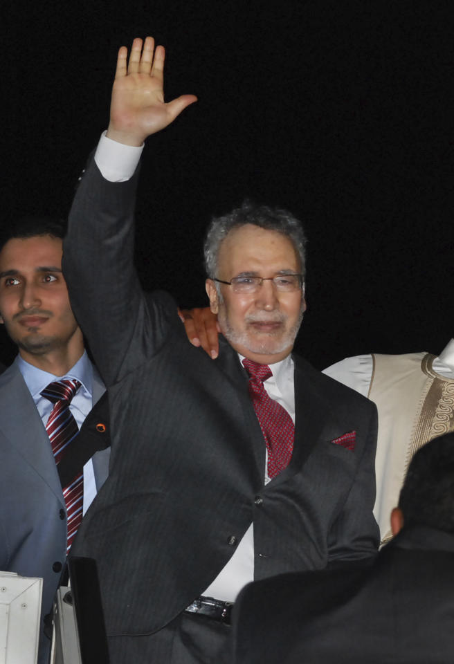 FILE - In this Aug. 20, 2009 file photo, Libyan Abdel Baset al-Megrahi, who was found guilty of the 1988 Lockerbie bombing, gestures on his arrival in Tripoli, Libya. The Libyan rebels' interim government says it will not deport the man convicted of the 1988 Lockerbie bombing. The rebel Justice Minister Mohammed al-Alagi told journalists in Tripoli Sunday that no Libyan citizen would be deported, even Abdel-Baset al-Megrahi, who was convicted in a Scottish court and imprisoned for the bombing of Pan Am flight 103, which killed 270 people, but then released due to sickness.(AP Photo, File)