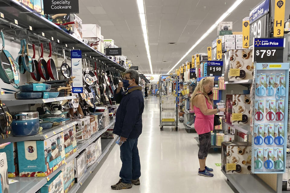 """FILE - Consumers shop at a Walmart store in Vernon Hills, Ill., Sunday, May 23, 2021. On Friday, Oct. 1, 2021, The Associated Press reported on stories circulating online incorrectly asserting that Walmart recently announced it will require customers in its stores to be vaccinated for COVID-19 starting Nov. 1. Walmart spokesperson Charles Crowson told the AP, """"That claim is false."""" (AP Photo/Nam Y. Huh, File)"""
