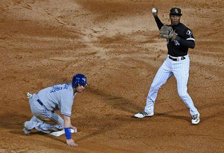 May 17, 2019; Chicago, IL, USA; Toronto Blue Jays first baseman Justin Smoak (14) slides safely in front of the tag of Chicago White Sox shortstop Tim Anderson (7) during the third inning at Guaranteed Rate Field. Mike DiNovo-USA TODAY Sports