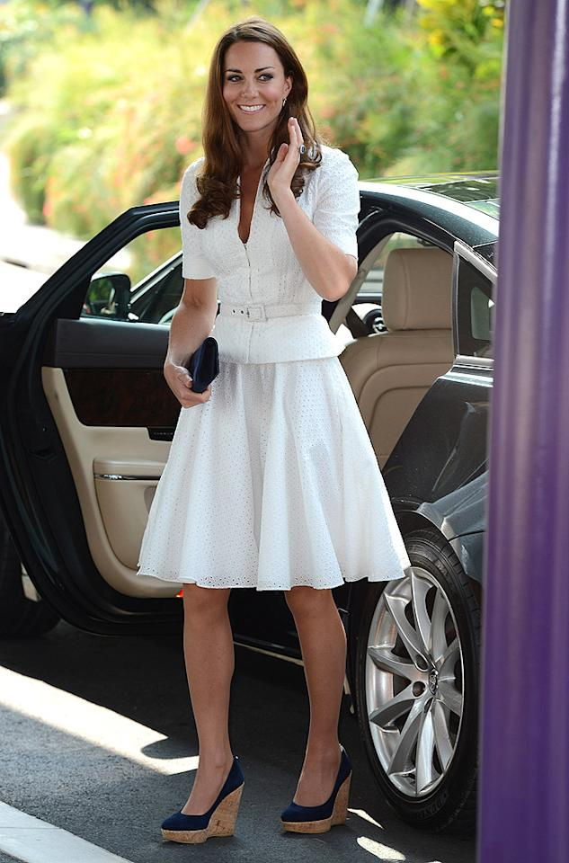 "Meanwhile in South East Asia, the Duchess of Cambridge was photographed wearing this effortlessly chic Alexander McQueen skirt suit (and casual Stuart Weitzman wedges) on day two of her nine-day Diamond Jubilee Tour. Do you like her navy kicks, or are they a tad too clunky? (9/12/2012)<br><br><a target=""_blank"" href=""http://omg.yahoo.com/news/prince-william-want-2-kids-kate-middleton-130000614.html"">Prince William wants two kids with wife Kate</a>"