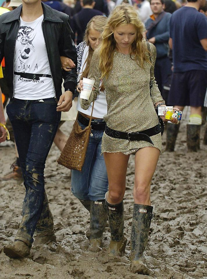 <p>The queen of cool, rocking a gold, sparkly mini dress and Hunter wellies covered in mud.</p>