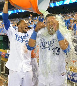 Salvador Perez (right) was 0 for 5 before his winning hit. (USA Today)
