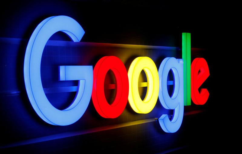 FILE PHOTO: An illuminated Google logo is seen inside an office building in Zurich September 5, 2018. REUTERS/Arnd WIegmann/File Photo