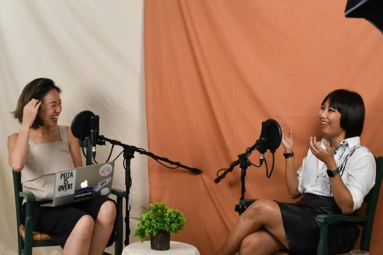 Taboo-busting Singaporean podcaster Nicole Lim (L) has won a following in socially conservative Asian societies