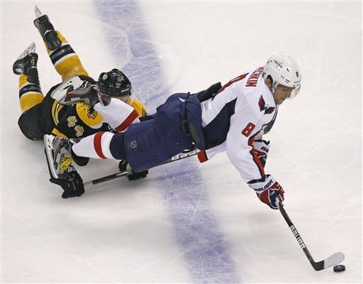 Washington Capitals left wing Alex Ovechkin (8) is tripped by Boston Bruins defenseman Dennis Seidenberg (44) during the second period of Game 2 of an NHL hockey Stanley Cup first-round playoff series in Boston, Saturday, April 14, 2012. AP Photo/Charles Krupa)