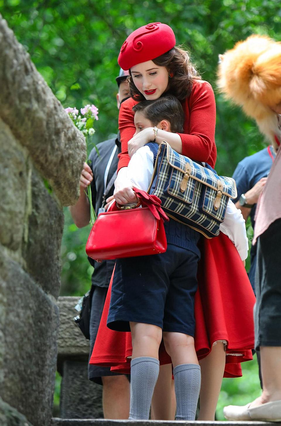 <p>Brosnahan gives her onscreen son, played by Nunzio Pascale, a hug between takes on June 10. </p>