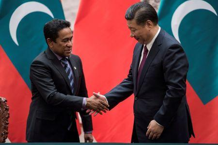 FILE PHOTO: Maldives President Abdulla Yameen shakes the hand of China's President Xi Jinping after a signing meeting at the Great Hall of the People in Beijing, China December 7, 2017. REUTERS/Fred Dufour/Pool/File Photo