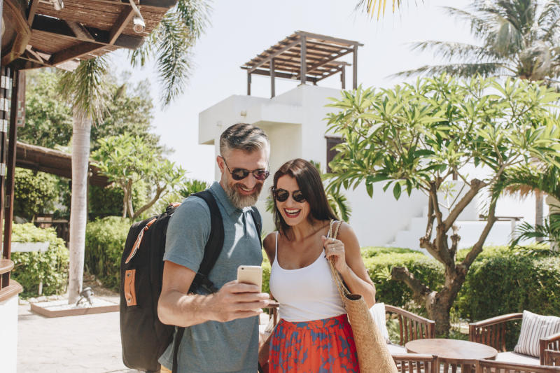 A happy couple in the courtyard of a tropical time-share resort.