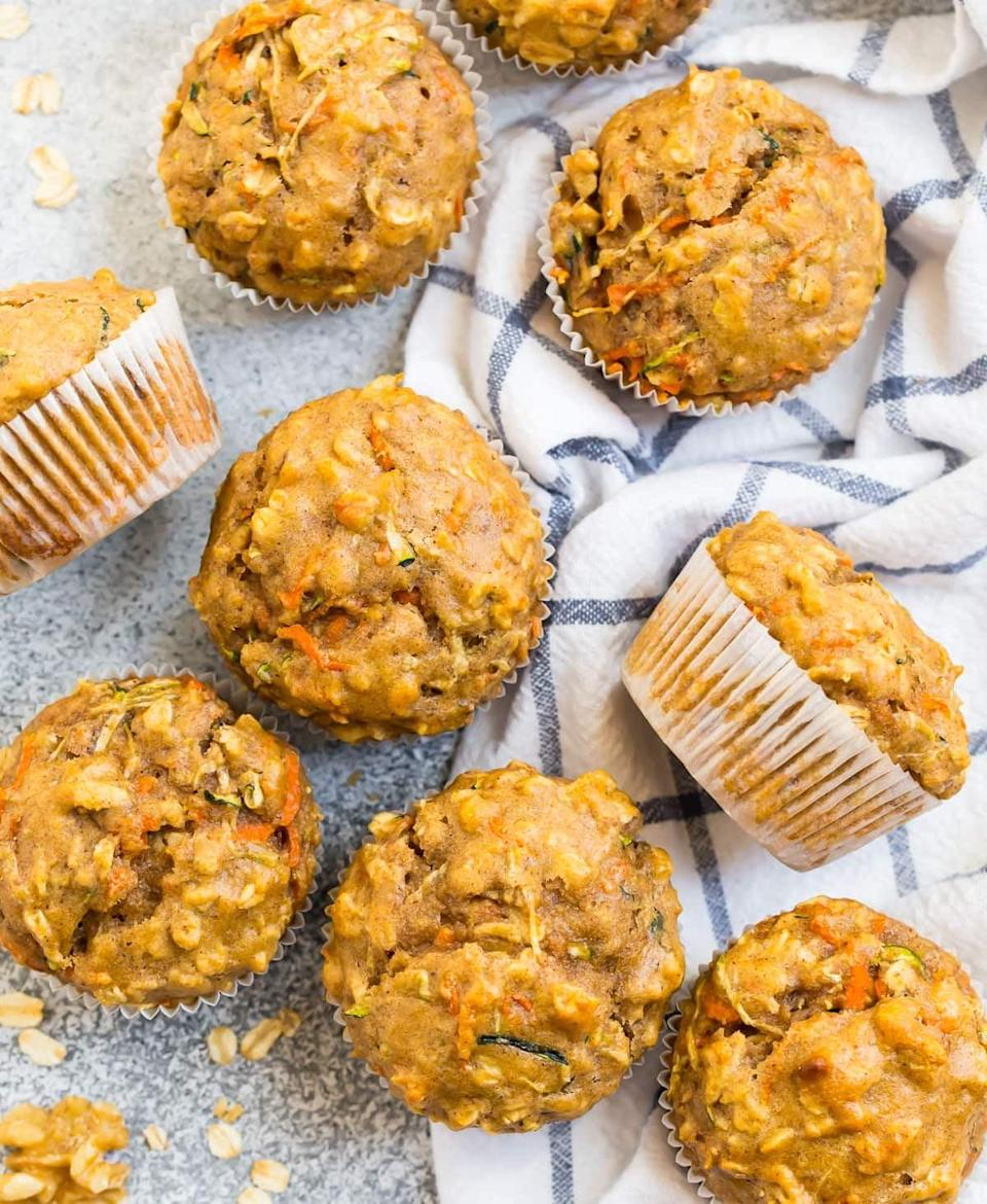 """<p>Dairy, veggies, and oatmeal in one easy-to-serve dish? These <a href=""""https://www.wellplated.com/zucchini-carrot-muffins/"""" class=""""link rapid-noclick-resp"""" rel=""""nofollow noopener"""" target=""""_blank"""" data-ylk=""""slk:zucchini carrot muffins"""">zucchini carrot muffins</a> from Well Plated by Erin combine it all for a perfect morning dish.</p>"""