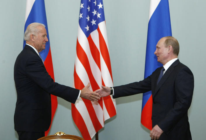 FILE - In this March 10, 2011, file photo, Vice President of the United States Joe Biden, left, shakes hands with Russian Prime Minister Vladimir Putin in Moscow, Russia. Putin won't congratulate President-elect Joe Biden until legal challenges to the U.S. election are resolved and the result is official, the Kremlin announced Monday, Nov. 9, 2020. (AP Photo/Alexander Zemlianichenko, File)