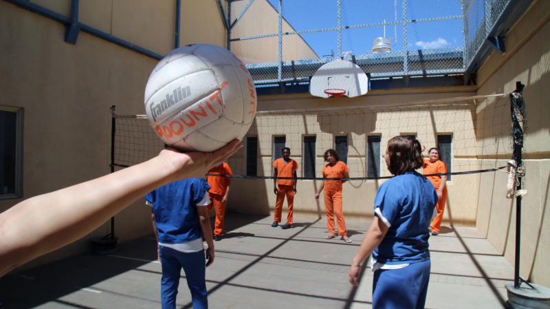 This June 6, 2019 image provided by U.S. Immigration and Customs Enforcement shows immigration detainees playing volleyball in the recreation yard of a dedicated unit for transgender migrants in the Cibola County Correctional Center in Milan, N.M. (Ron Rogers/U.S. Immigration and Customs Enforcement via AP)