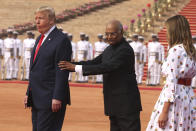 FILE - In this Feb. 25, 2020, file photo, Indian President Ram Nath Kovind, center, holds the arms of U.S. President Donald Trump, as first lady Melania Trump walks behind them for a photo op during a ceremonial welcome for Trump at the Indian Presidential Palace in New Delhi, India. (AP Photo/Manish Swarup, File)