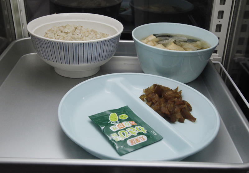 A plate of breakfast for an inmate is displayed during a press tour of the Tokyo Detention House in Tokyo, Monday, June 10, 2019. With its bare cells, the Tokyo Detention House looks much like a high-security prison, but those who get incarcerated here, including former Nissan Chairman Carlos Ghosn, have not been convicted of any crime.(AP Photo/Koji Sasahara)