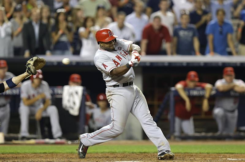 Los Angeles Angels' Chris Nelson (8) strikes out with bases loaded for the third out in the top of the ninth-inning of the Angels 2-1 loss to the New York Yankees in a baseball game, Monday, Aug. 12, 2013, in New York. (AP Photo/Kathy Willens)