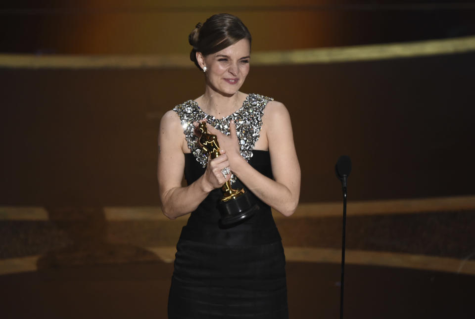 """Hildur Guonadottir accepts the award for best original score for """"Joker"""" at the Oscars on Sunday, Feb. 9, 2020, at the Dolby Theatre in Los Angeles. (AP Photo/Chris Pizzello)"""