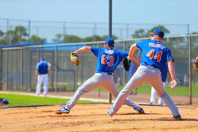 <p>New York Mets minor league pitchers Joe Shaw and Josh Prevost work in sync during a bullpen at the Mets Minor League Complex in Port St. Lucie, Fla., on March 1, 2018. (Photo: Gordon Donovan/Yahoo News) </p>